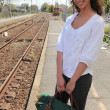 Woman waiting for train Delaire_Constance_150410 - Stock Photo