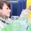 Woman recycling plastic - Stock Photo