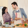 Couple cooking together in the kitchen — Photo