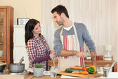 Couple cooking together in the kitchen — Stock Photo