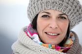 Brunette wearing hat and scarf — Stock Photo