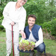 Young mgardening with older woman — Stock Photo #13930531