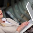 Blond woman with computer — Stock Photo