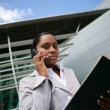Stock Photo: Businesswoman making a call outdoors