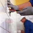 Two electrician working in public rest room — Stock Photo