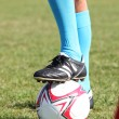Closeup of footballers legs with boot on ball — Stock Photo