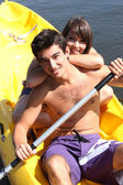 Couple in a canoe — Stock Photo