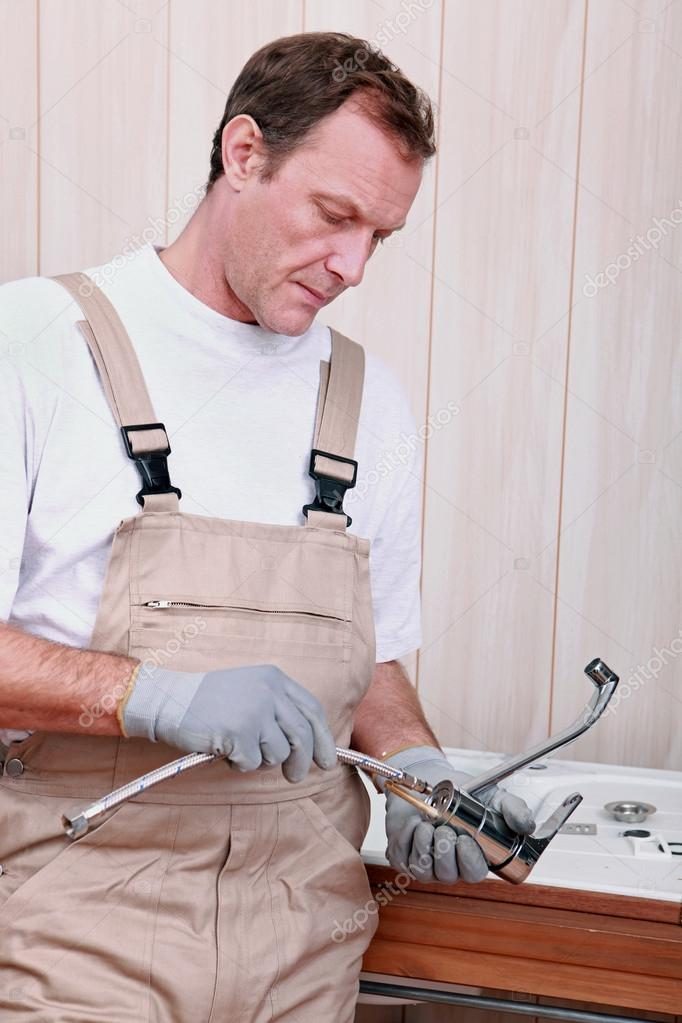 Plumber with tap — Stock Photo #13933282