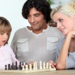 Family playing chess together — Stock Photo #13989620