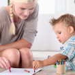 Mother and son drawing — Stock Photo #13989639