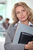 Businesswoman holding folders — Stock Photo