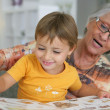Grandmother reading with toddler — Stock Photo