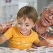Stock Photo: Grandmother reading with toddler