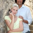 Stock Photo: Summery couple with cellphone
