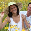 Stock Photo: Couple in field of flowers