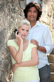 Summery couple with a cellphone — Stock Photo