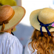 Stock Photo: Two women wearing straw hats