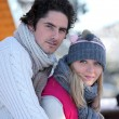 Couple enjoying their winter holiday — Stockfoto #14015597