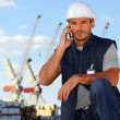 Stock Photo: Foreman using radio to communicate on site