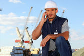 Foreman using radio to communicate on site — Foto Stock