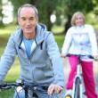 Senior couple riding bikes — Stock Photo #14021892