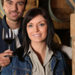 Young couple tasting wine in their cellars Dubroca_Joffrey_140410;Bounie_Au - Stock Photo