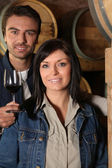 Young couple tasting wine in their cellars Dubroca_Joffrey_140410;Bounie_Au — Stock Photo