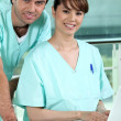 Two nurses standing by the reception area — Stock Photo