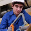 Young laborer using saw — Stock Photo #14032222