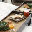 Stock Photo: Break trays on bed