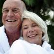 Senior couple in bathrobes — Stock Photo