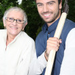 Older lady and gardener — Stock Photo