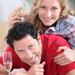 Couple with a glass of champagne — Stock Photo #14033344