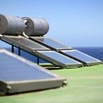 Solar panels by the coast — Stock Photo