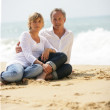 Adult couple at the beach — Stock Photo