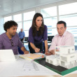 Stock Photo: architect with plans and 3d model