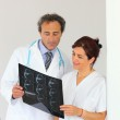 Radiologist getting a second opinion — Stock Photo