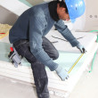 Stock Photo: Mmeasuring insulation boards