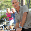 Portrait of a man on a bike — Stock Photo #14036031