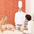 Chef talking to a couple in a restaurant — Stock Photo