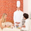 Chef talking to a couple in a restaurant - Stock Photo