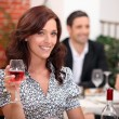 Woman holding a glass of wine — Stock Photo