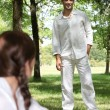Stock Photo: Young couple in forrest dressed in white clothing