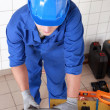 Plumber measuring plastic pipe — Stock Photo