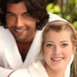Couple in dressing gowns — Stock Photo