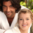 Couple in dressing gowns — Stock Photo #14037231