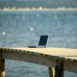 Stock Photo: Laptop left on pier