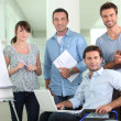 Office worker in a wheelchair with colleagues — Stock Photo