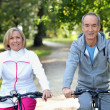 Senior couple on bike ride — Stock Photo