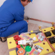 Stock Photo: Plumber fitting copper pipes